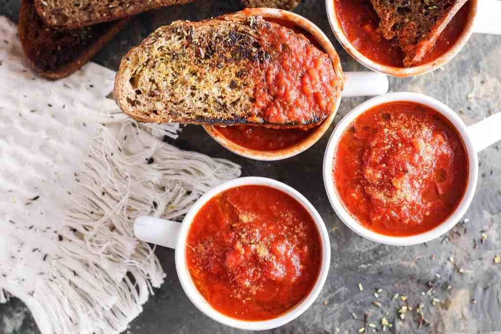Delicious vegan recipe for easy tomato soup served with homemade fried whole grain bread. Healthier plant-based comfort food for fall!