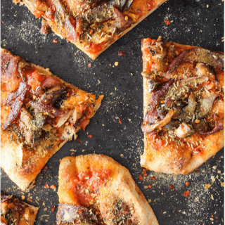 Vegan naan pizza is a healthy, fun, and delicious weeknight meal that the entire family will love. Caramelized onions and sautéed mushrooms are a flavorful combination that you'll want to top your pizza with over and over again.
