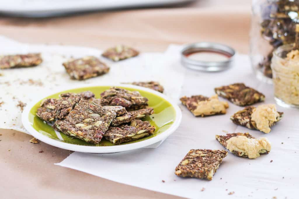Make your own chia seed crackers with this simple plant-based recipe. Healthy and delicious snack that's portable and travel-friendly!