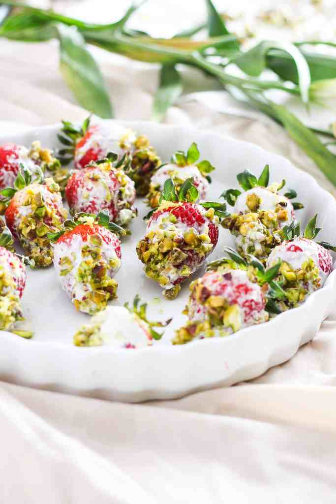 4 basic ingredients are all you need to create these deceivingly simple yogurt dipped strawberries, perfect for a quick healthy snack or impressive dessert while entertaining.