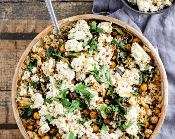 This comforting Mediterranean main dish needs to be in your weeknight rotation! Greek-seasoned roasted chickpeas served with vegan tofu feta, spicy greens, and freekeh.