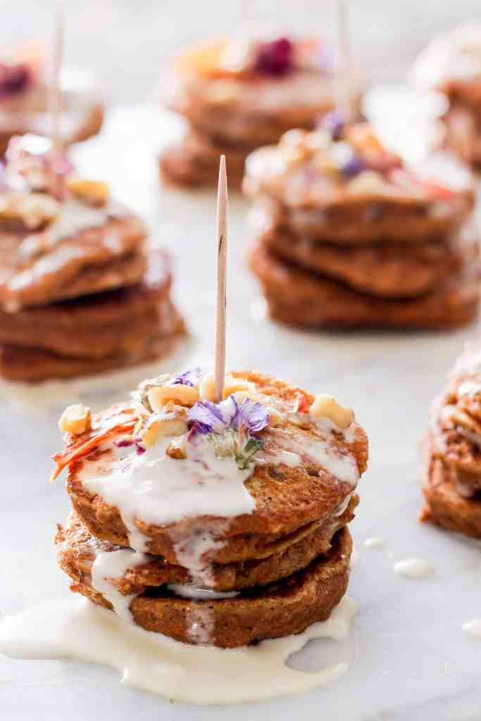 Mini carrot cake pancakes with maple mascarpone are the perfect addition to your spring party menu—or serve them for dessert. Edible flowers optional!
