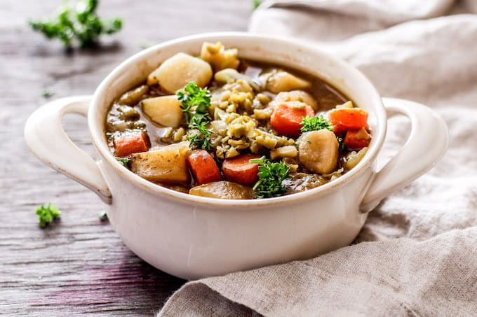 Irish stout stew made extra cozy with root vegetables and split peas. This healthy, vegetarian slow cooker recipe is perfect for St Patrick's Day!