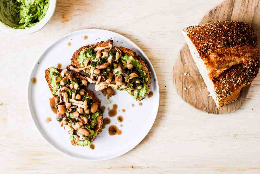 Mushroom avocado toast. A delicious recipe for savory breakfast lovers who don't like eggs. Topped with white beans for extra plant-based protein!