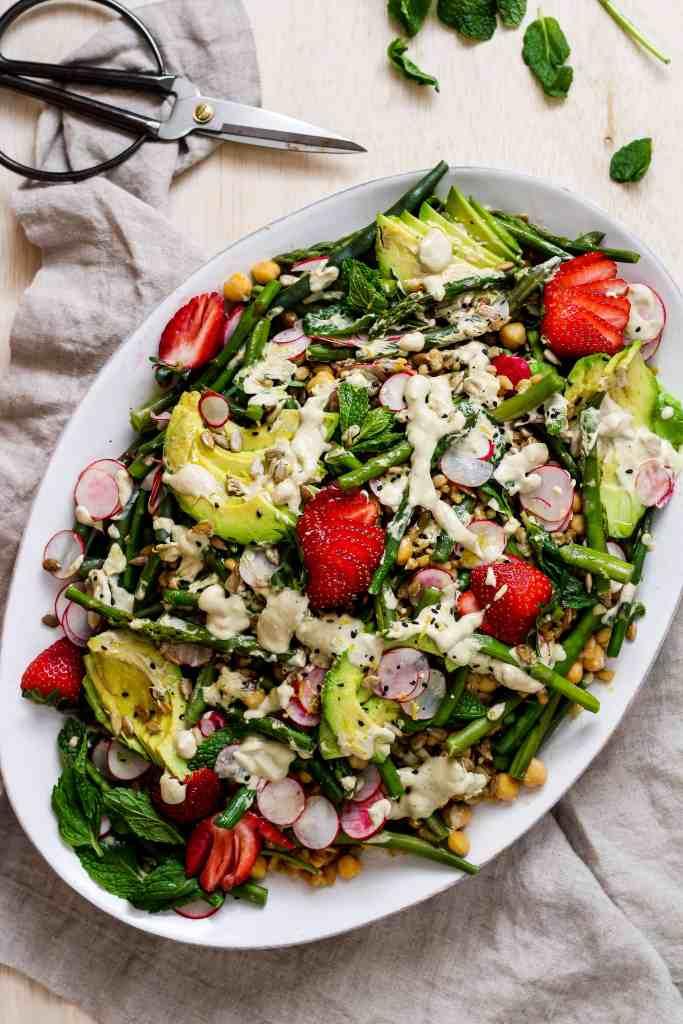 Spring farro salad. Upgrade your regular grain salad with spring vegetables and creamy, lemon tahini dressing.