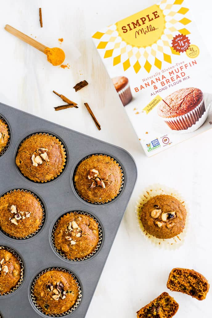 Overhead shot of gluten-free golden milk muffins in a muffin tin with Simple Mills baking mix.