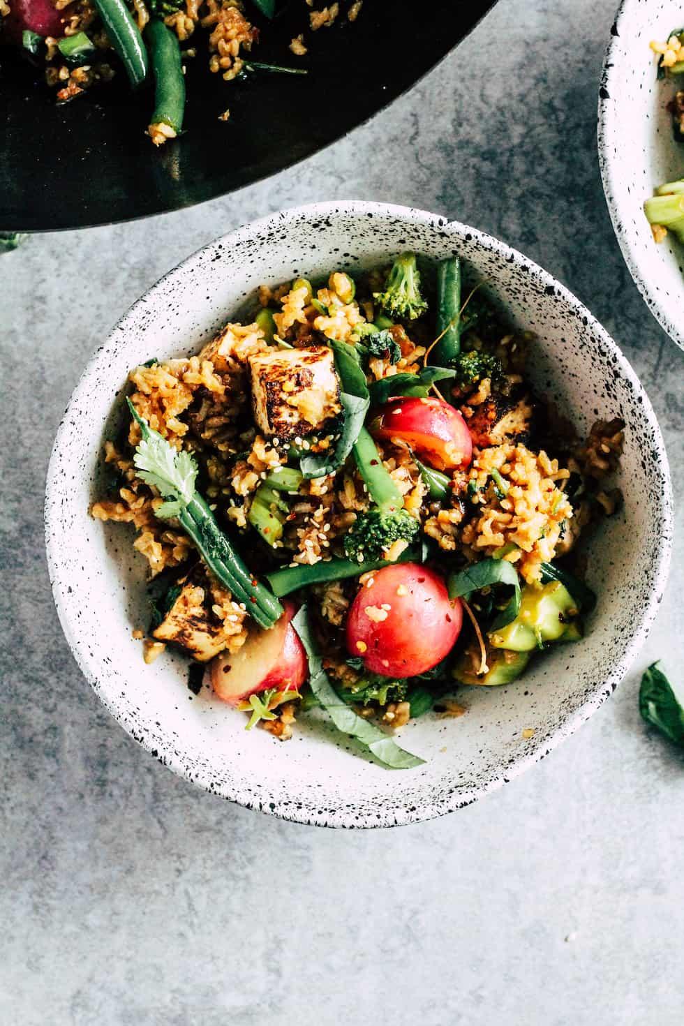 Overhead image of veggie fried rice in white ceramic bowl.
