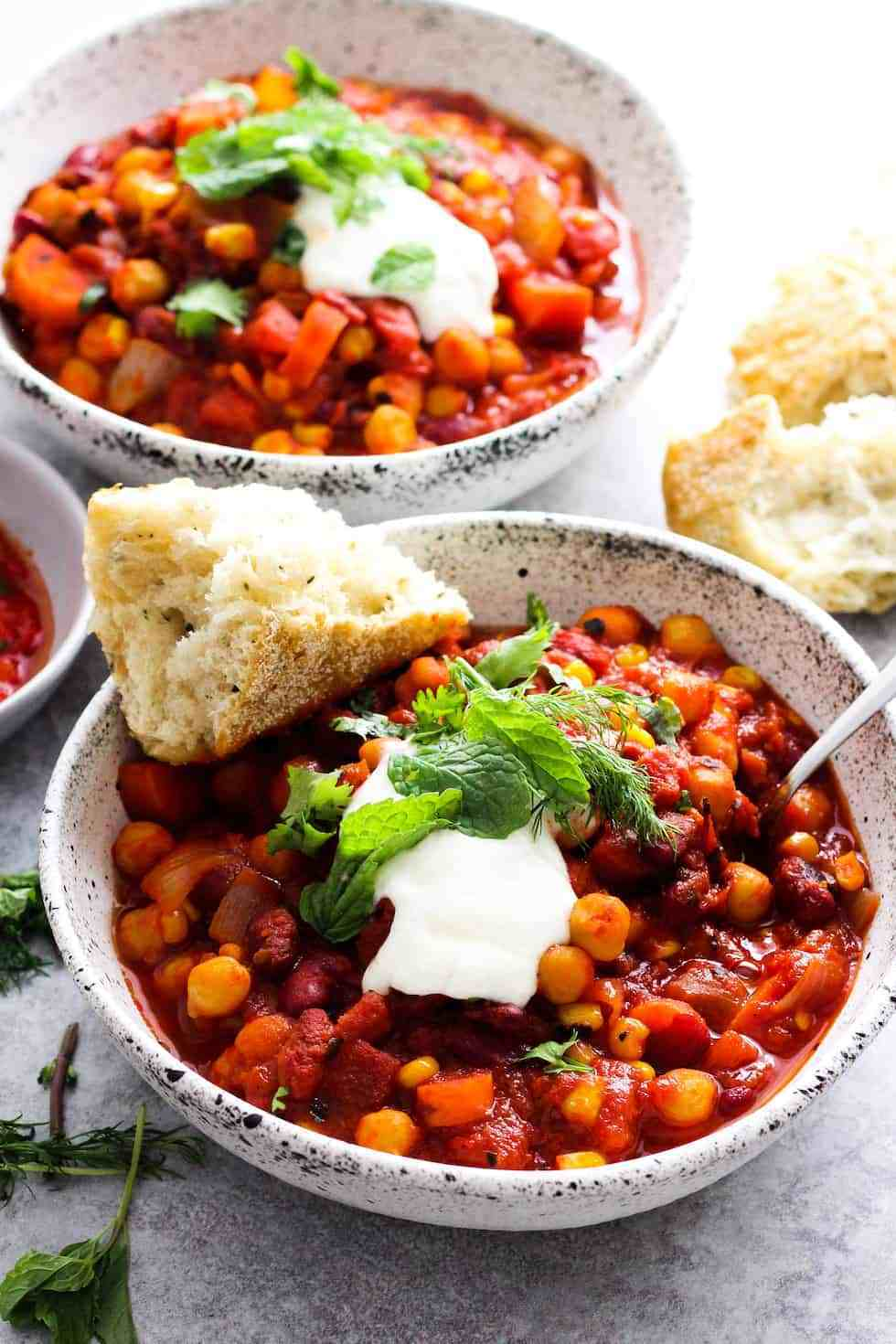 Bowl of harissa chili with bread on the side as a meal idea that uses pantry ingredients.