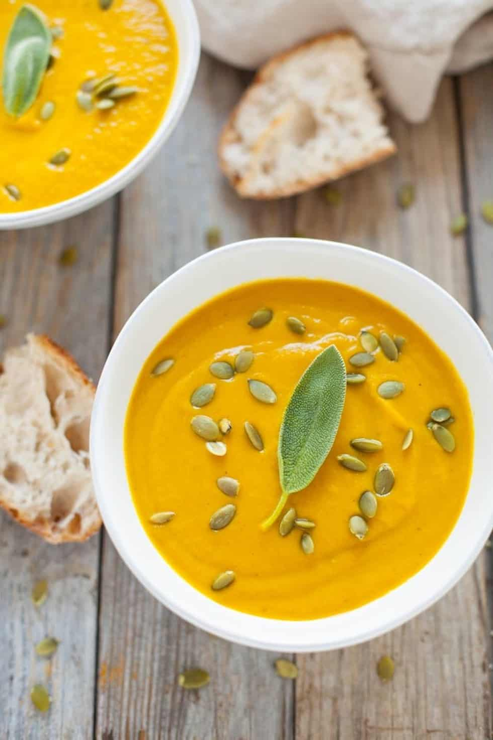 Yellow pumpkin soup with sage and pumpkin seeds.