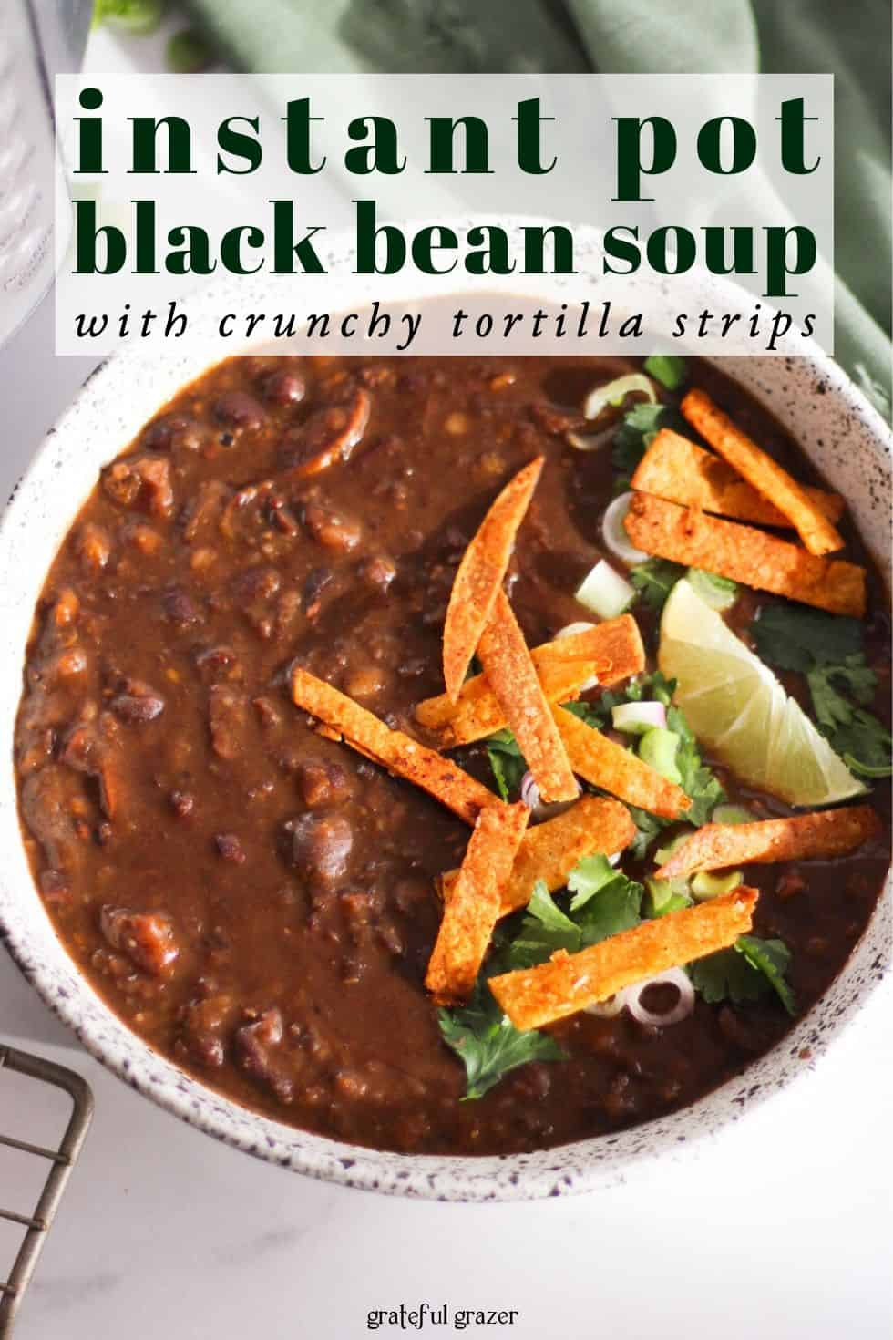 "Bean soup in white bowl with text that reads, ""instant pot black bean soup with crispy tortilla strips."""