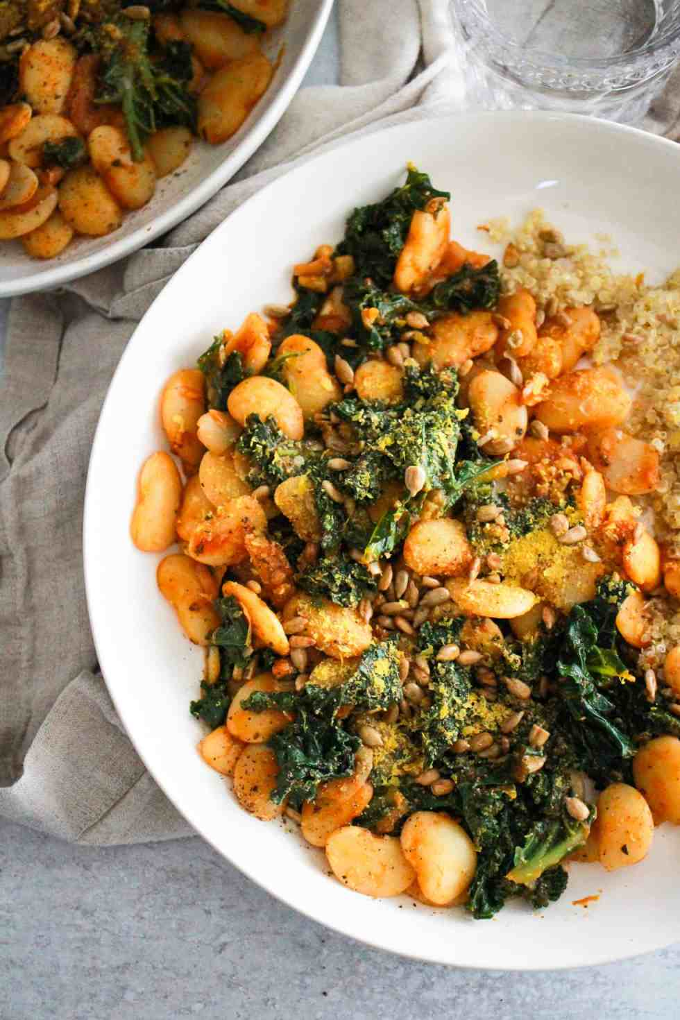Closeup image of butter beans recipe with kale and quinoa.