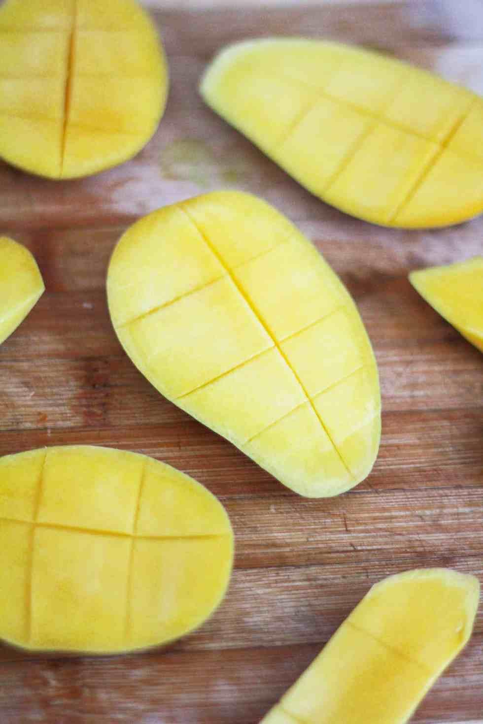 Scored mangoes illustrating how to dice a fresh mango.