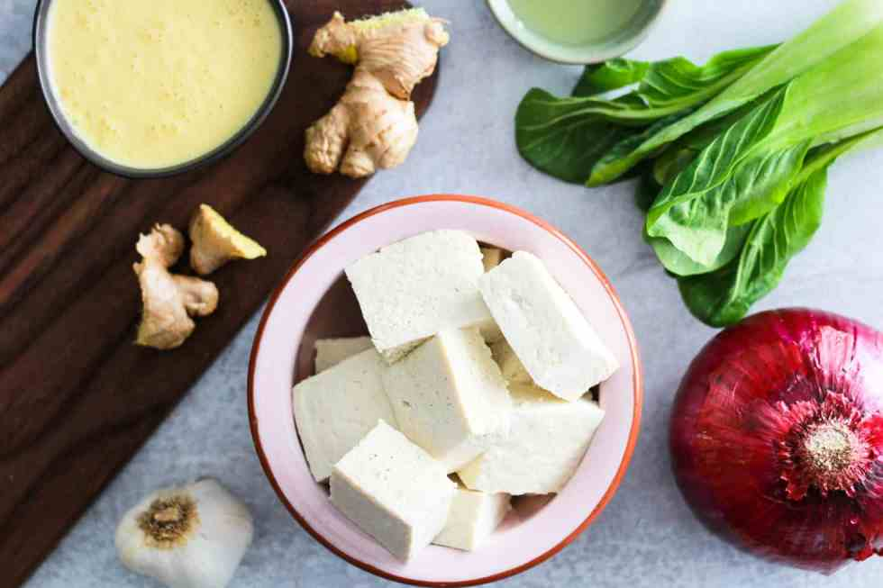 Flatlay image of tofu and mango kefir sauce ingredients.