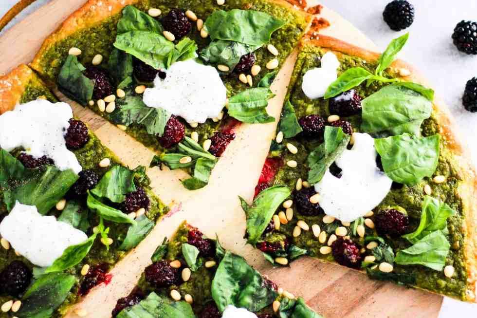 Horizontal image of sliced Blackberry Pesto Pizza.