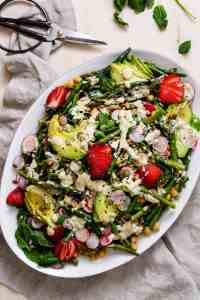 green salad on white platter featured in vegetarian email newsletter.