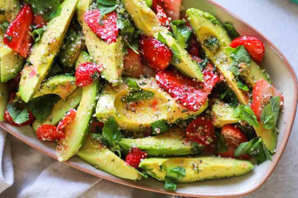 Horizontal image of strawberry avocado hemp salad.