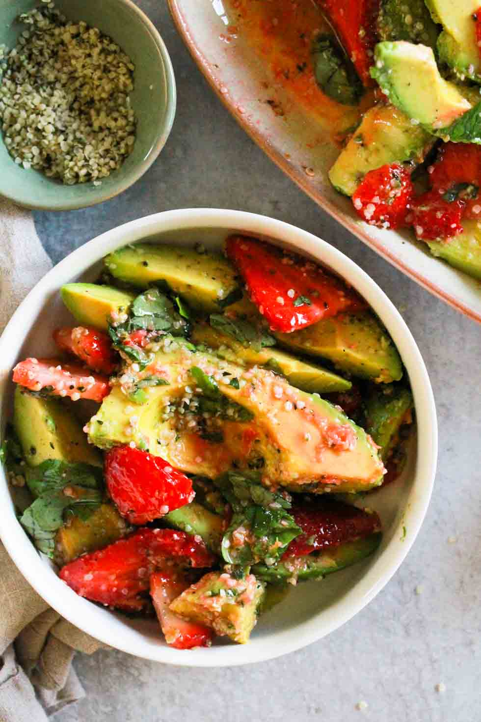 Strawberry Hemp Avocado Salad in a white bowl.