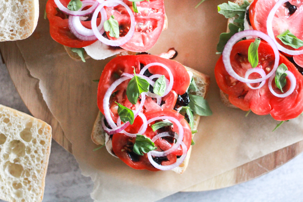 Open sandwiches with tomato, onion, and basil