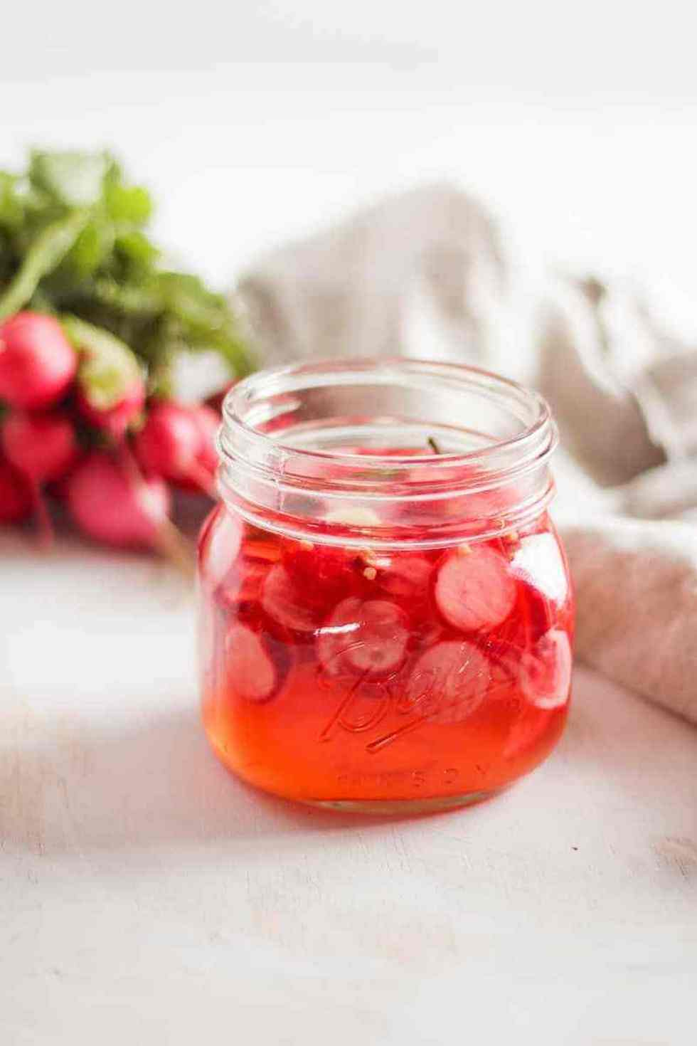 Glass jar with pickled radishes
