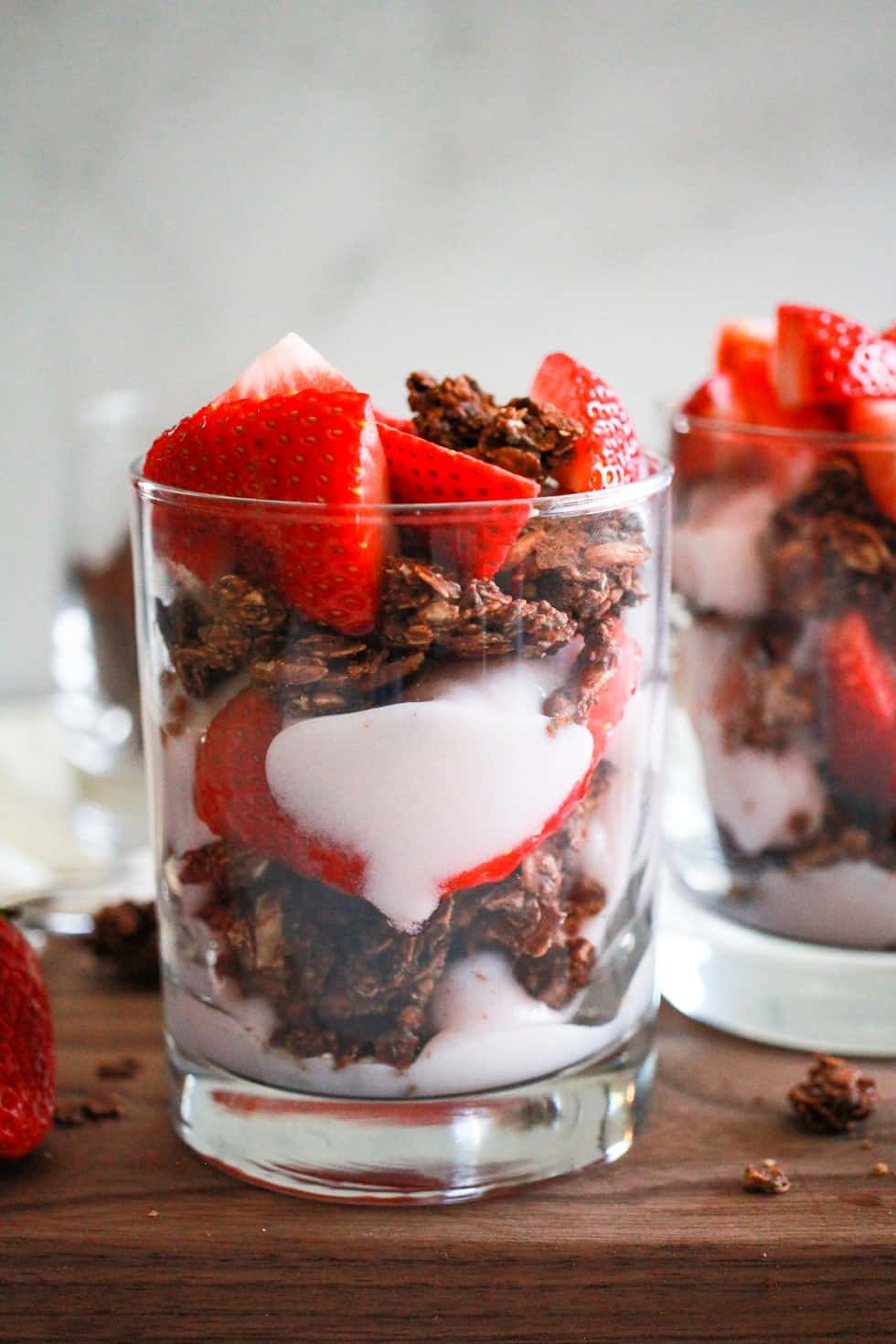 Strawberry Yogurt Parfait in a glass with granola.