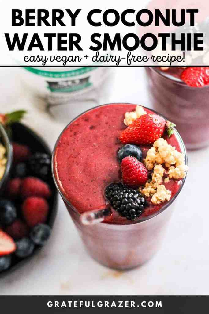"""Berry smoothie in a glass topped with fresh berries and granola with text, """"Berry Coconut Water Smoothie: easy vegan and dairy-free recipe!"""""""