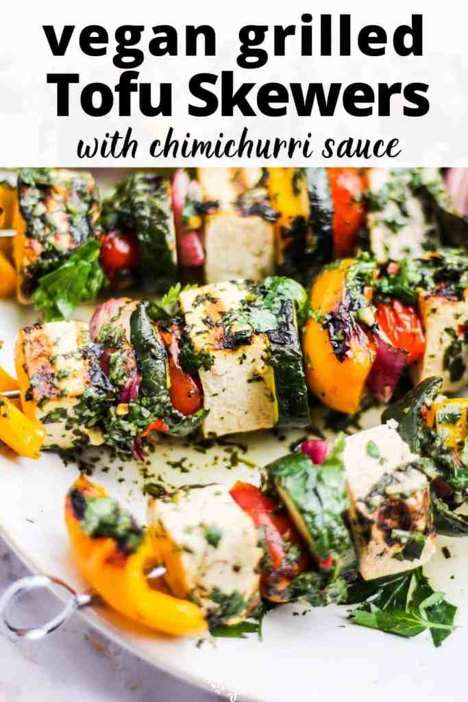 """Closeup of tofu skewers on a serving dish with text reading, """"vegan grilled tofu skewers with chimichurri sauce."""""""