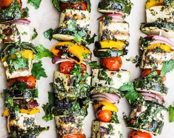 Chimichurri Grilled Tofu Skewers on parchment paper.