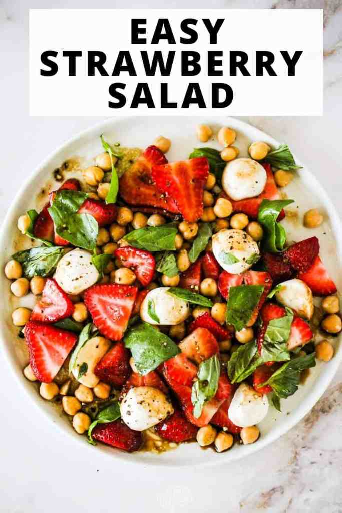 """Overhead image of a Summer Strawberry Salad with mozzarella and chickpeas. Text reads, """"Easy Strawberry Salad."""""""