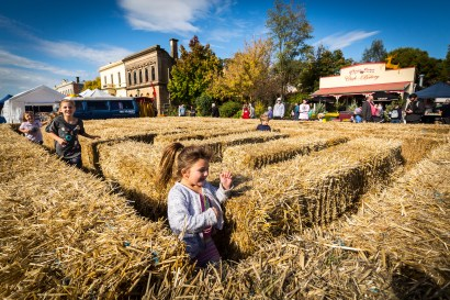 Children play in the Hay Bale Maze designed by artist Marion Anderson at the 2017 Clunes Booktown Festival. Photograph by Chris Hopkins