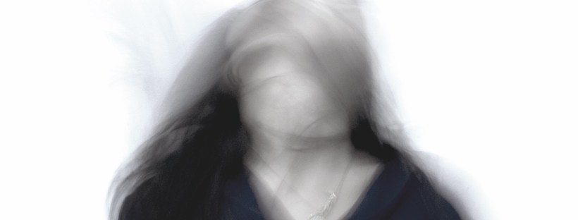 Woman with an overactive mind, slow shutter photograph