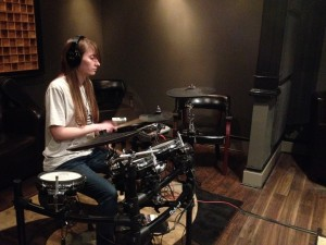 Kristen laying down a beat