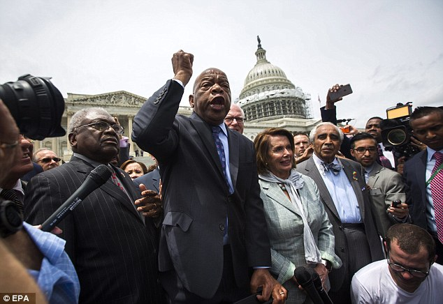 James Clyburn on left, John Lewis standing in the middle, and Nancy Pelosi to Mr. Lewis' left (our right in photo)