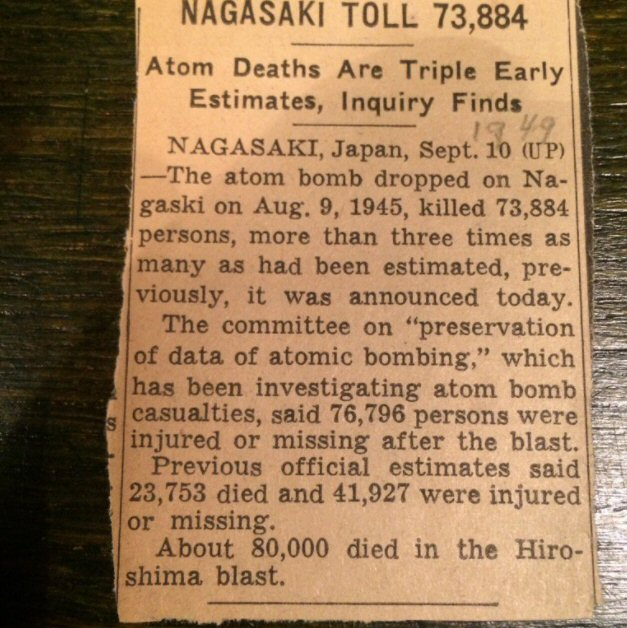 Old newspaper clipping with information about deaths, injuries, and missing from atomic bombs America dropped in Japan.