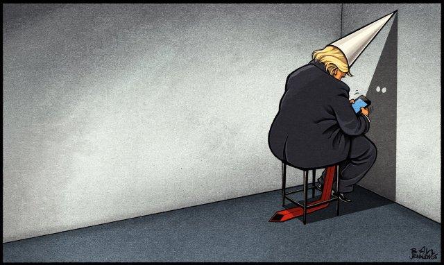 Trump in KKK dunce cap, sitting in corner tweeting.