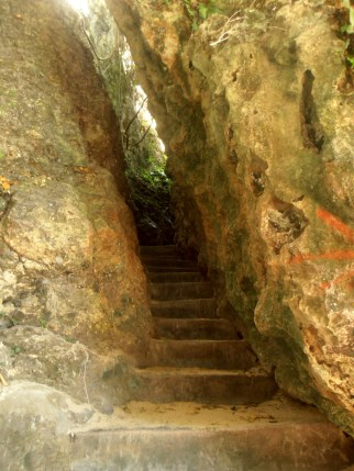The narrow natural-cave stairs