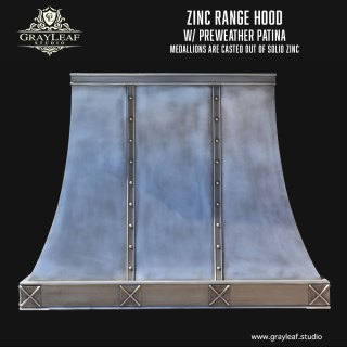 Zinc custom range hoods with medallions made of solid casted zinc