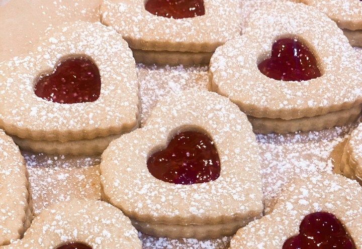 Picture of jam filled heart cookies with powdered sugar that are vegan and gluten free