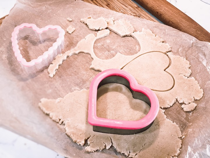 Cookie dough with a heart cookie cutter
