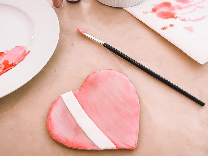Painting valentine's day heart cookies