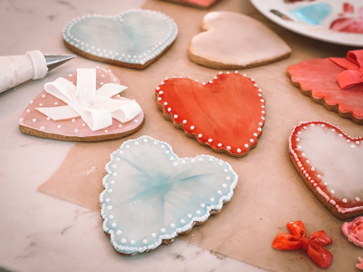 Decorated valentine's day heart cookies with royal icing