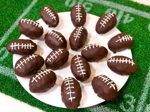 chocolate covered peanut butter rice krispies footballs