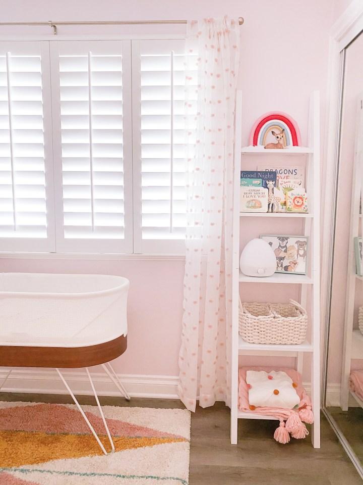 baby girl pink nursery shelves and snoo