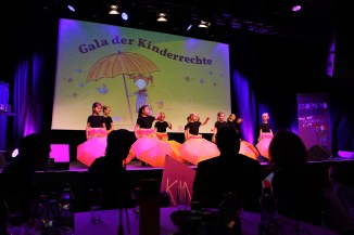 A lovely performance with turning umbrellas