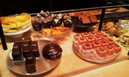 The showcase with all the tarts, muffins, and all sorts of other goodies