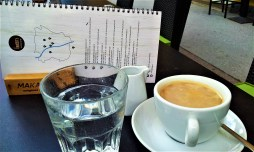 My Verlängerter Coffee and a map of the barista cafe's in Graz