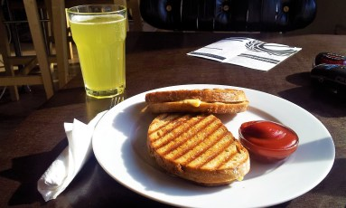 The cheese toast with my pineapple juice with soda