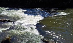 The rushing river Mur with its white water rapids