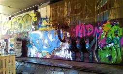 The graffiti art below the bridge next to the Citybeach Graz