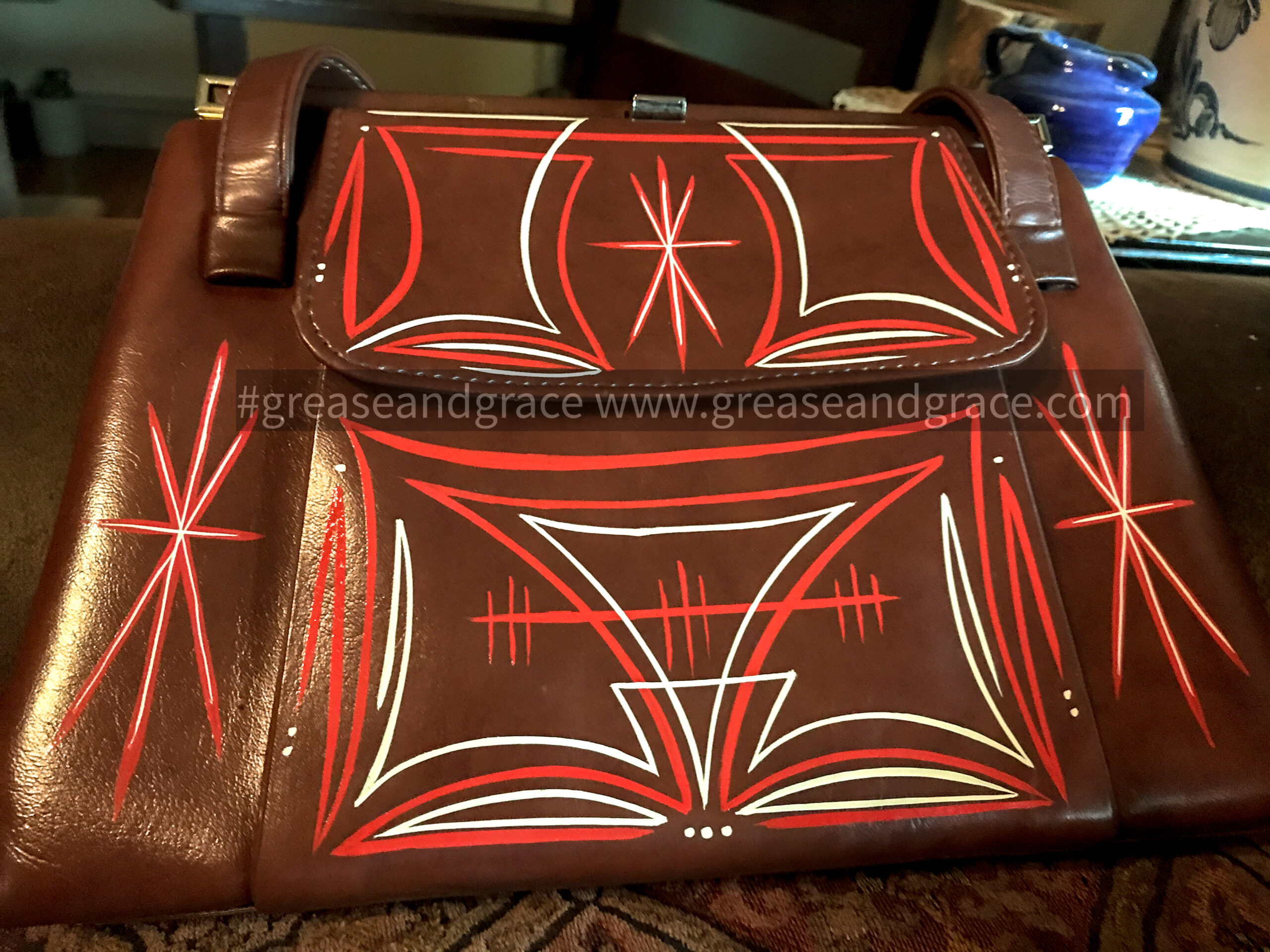 pinstriped vintage purse in orange and tan and white colors