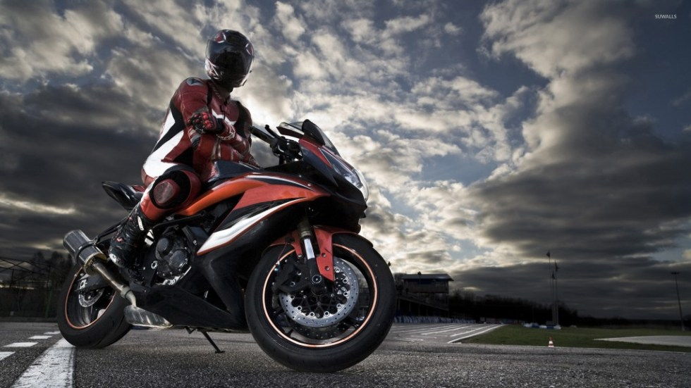 riding-a-black-and-red-motorcycle-47481-1920x1080